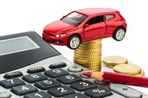 car and calculator. rising costs for car purchase, lease, worksh